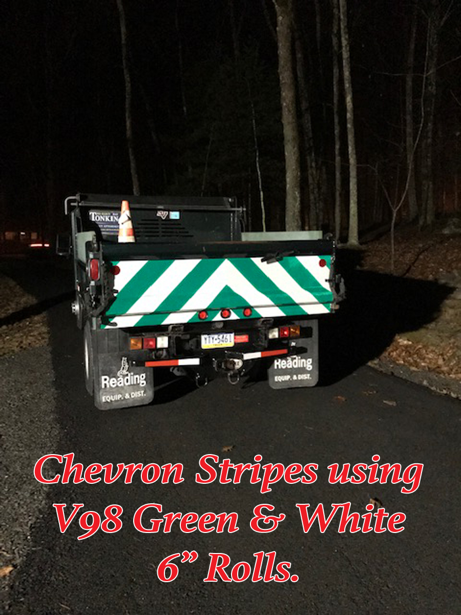 green white reflective panel dump truck