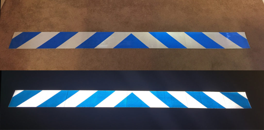 blue and white reflective chevron panel